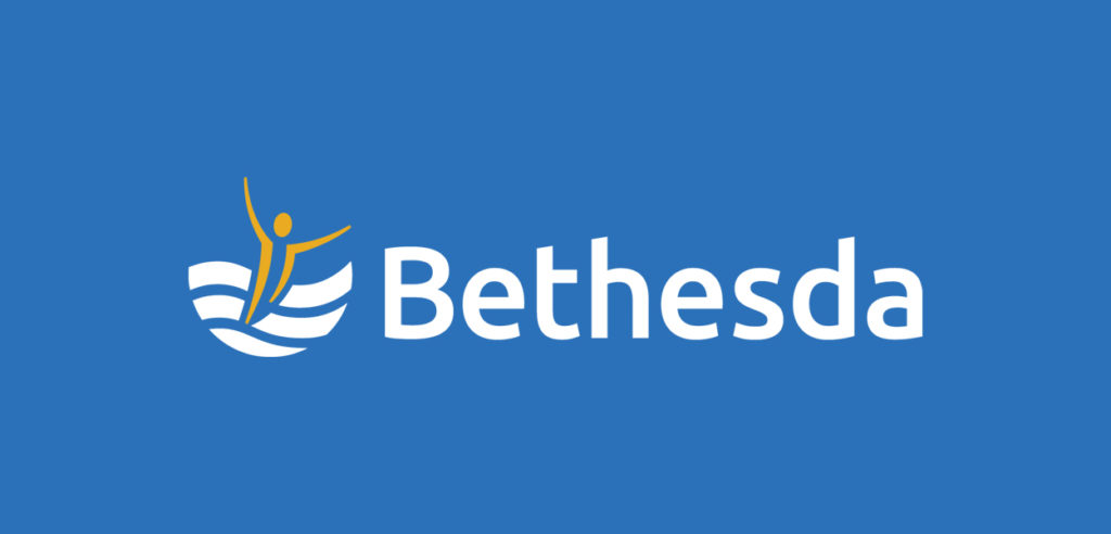 Two color Bethesda Logo on blue background