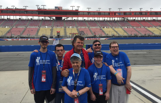 Michael Waltrip among 6 Disability Ambassadors on a racetrack